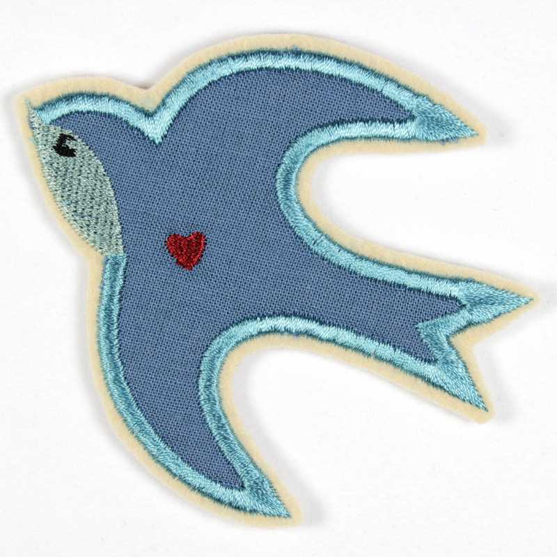 Iron-on patch of the bird swallow with a heart as an applique to iron on or a patch and accessories