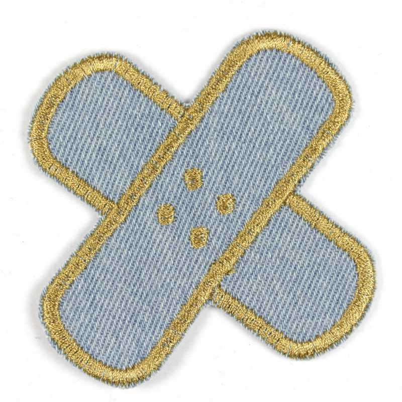 Iron-on cross plasters in light jeans with a golden edge, well suited as knee or trousers patches