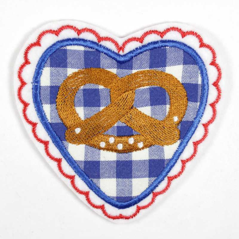 Iron-on patch with blue and white heart and embroidered pretzel as appliqué and accessory