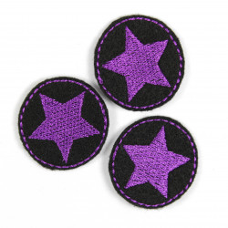 3 iron on patches around black applique with purple violet star