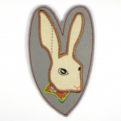 Iron-on hare in the shape of a heart as an applique for ironing on or patches and accessories