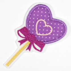 Iron-on lollipop in the shape of a heart as an iron-on appliqué or patch and accessories