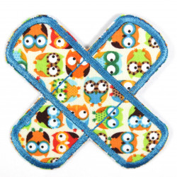 Patches in the shape of a cross to iron on with colorful owls as a motif