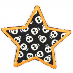 Iron-on patches in a star shape with small skulls as motifs that glow in the dark and neon orange border