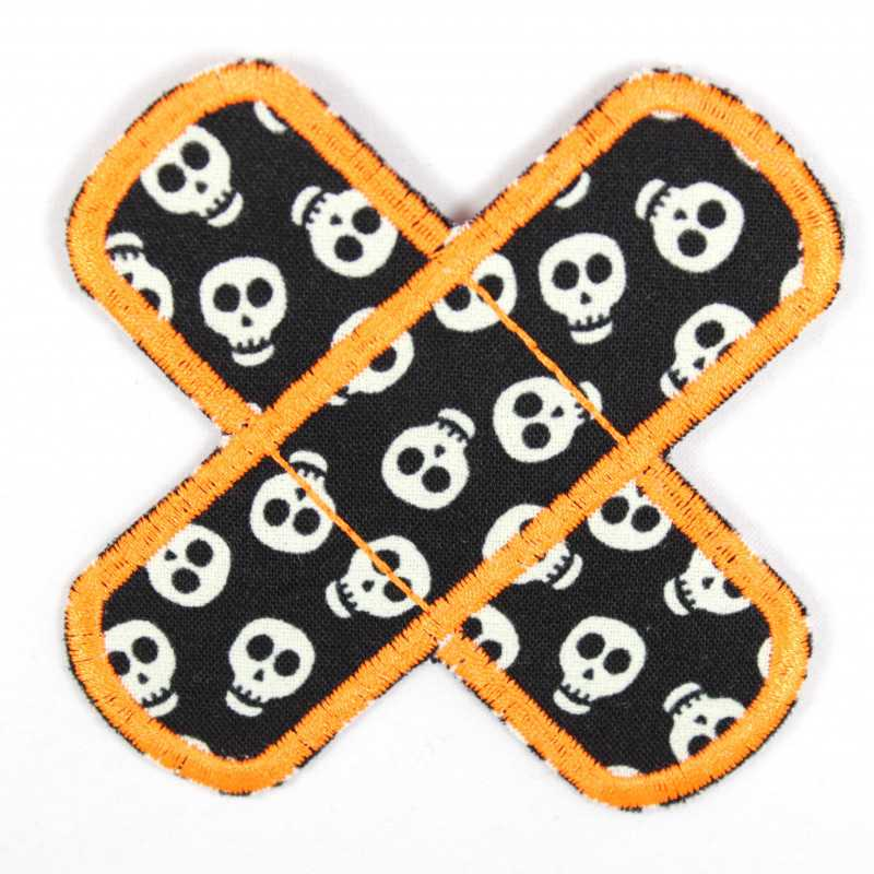Patches in the shape of a cross to iron on with white skulls glowing in the dark and neon orange edging