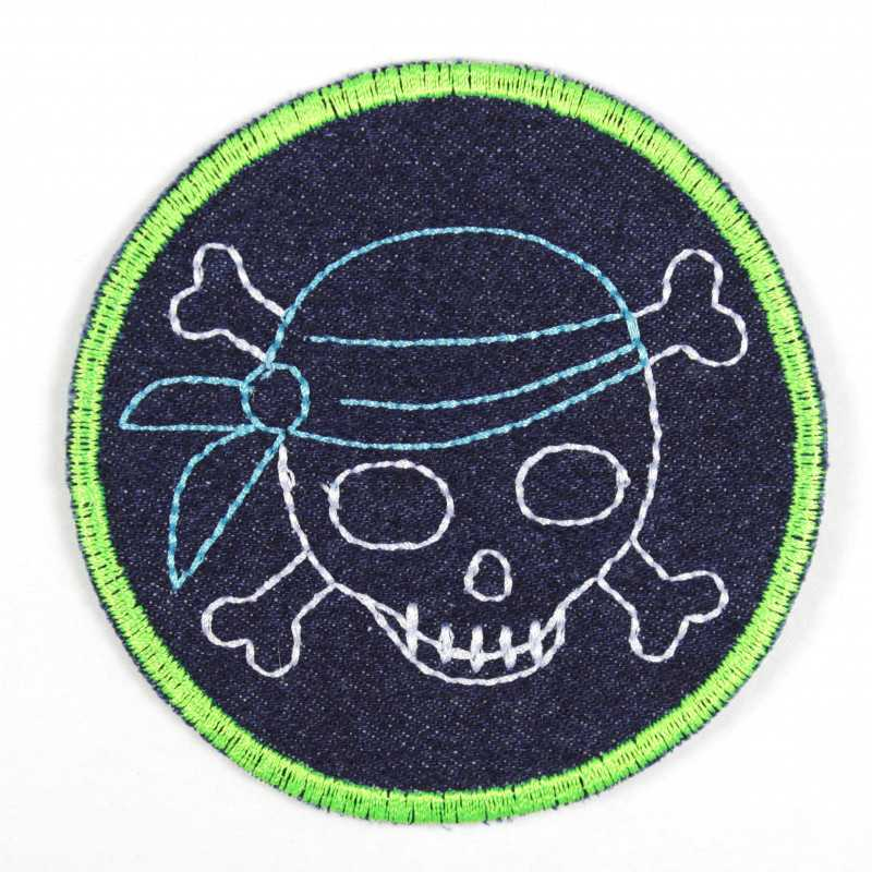 Iron-on patches with embroidered pirate and neon green edging on dark blue jeans, ideal as a knee or trouser patch