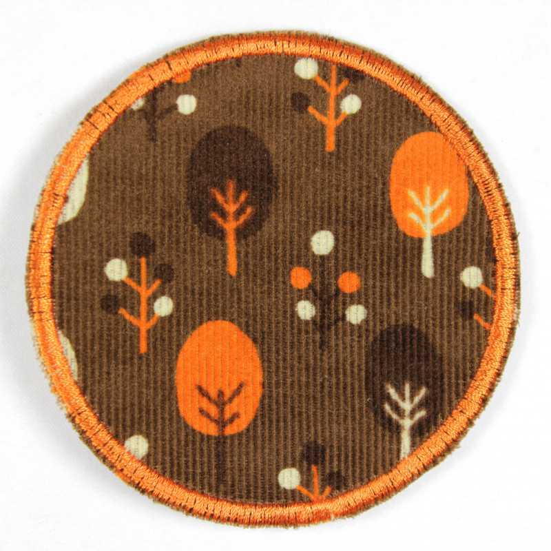 Iron-on patches round with trees on a brown tear-resistant patch as a knee patch for ironing on
