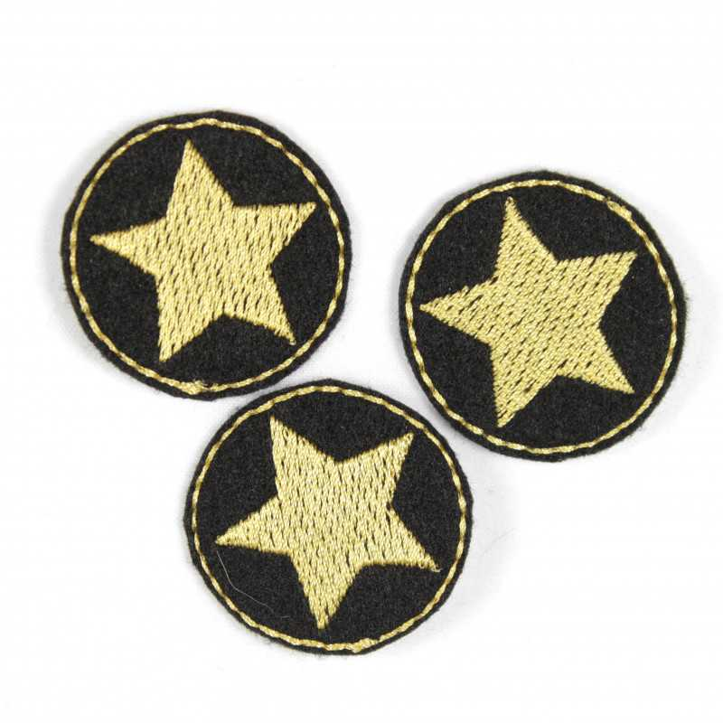 3 iron on patches around black applique with golden star embroidery