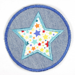 Iron-on patches around jeans with an applied star with a colorful star motif, suitable as knee patches