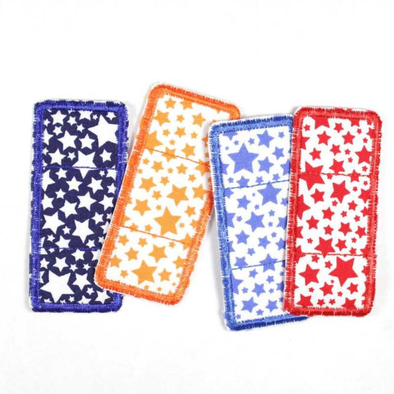 Set with four patches in plaster form with star motif in white, orange, light blue and red, suitable as knee patches