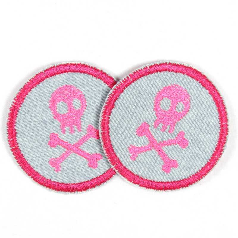 2 round patches with pink skulls on jeans light blue tearproof and ideal as a knee patch