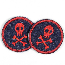 2 patches round with red skulls on jeans dark blue tearproof and ideal as a knee patch