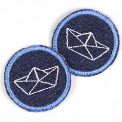 2 patches round with folding boat white on dark blue jeans with a blue embroidered edge