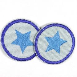 Flickli rund blauem Stern auf hellblau