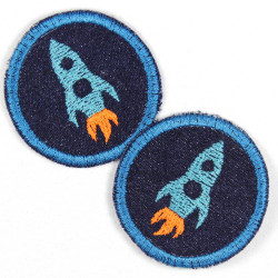 Flickli rund Rakete auf blau