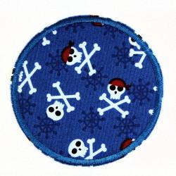 Flickli rund skulls auf blau