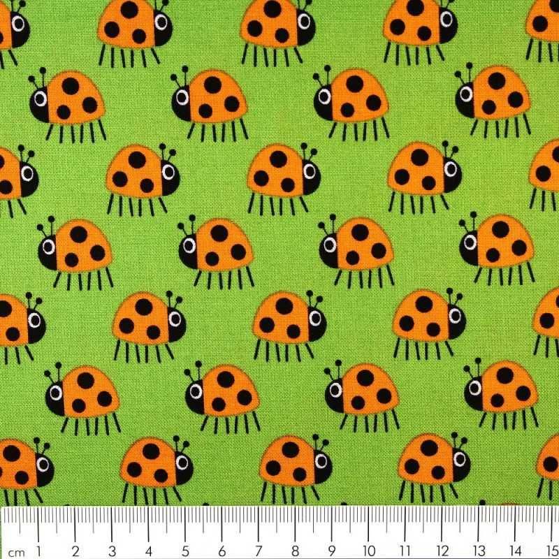 Scandinavian fabrics Copenhagen design cotton fabric ladybug orange on green