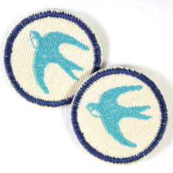 swallow iron on patches round with blue birds on creme white fabric