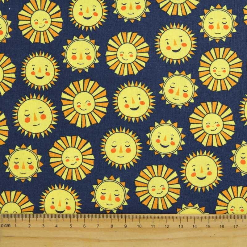 Fabric sunning Robert Kaufman fabrics Daydreamer sun with face sky fabric yellow on dark blue happy kids fabric