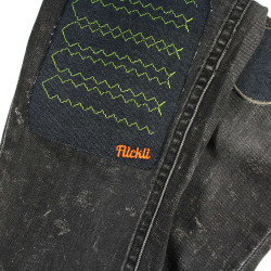 large iron-on patch graphic visible  textile repair on pants