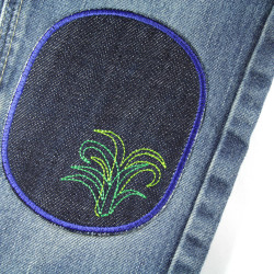 Repair trousers with large patches on kid's trousers. Repair jeans with knee patches