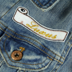 "Patch toilet paper on denim jacket with golden lettering ""LUXUS"" patch for adults"
