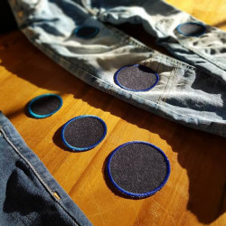 Jeans blue jeans with blue round patches