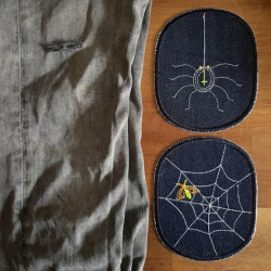 Repair the crack in the trousers with patches to iron on the spider and cobweb motif