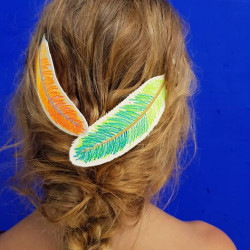 Feather accessory as a hair clip with patches on the back