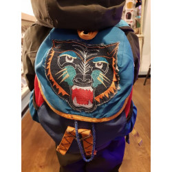 Backpack designed with tiger appliqué