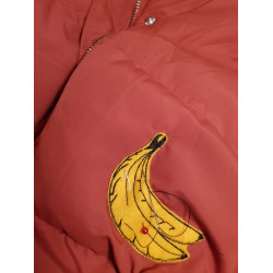 Patching down jacket with iron-on banana, simply sew on