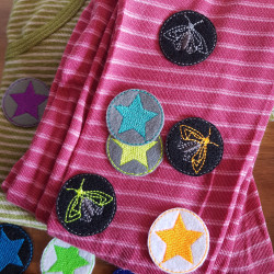 Repair shirt with small round patches to iron on Iron-on patch with star and moth motif