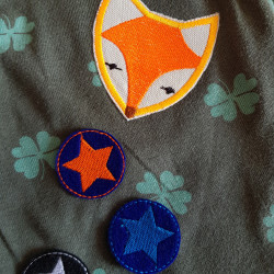 Fox applique and small round star iron-on patches on a T-shirt with shamrock