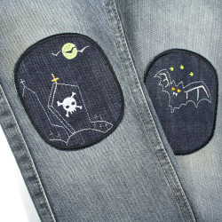 Children's pants jeans with iron-on patches bat and tombstone repaired by simply ironing on