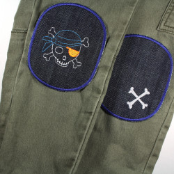 Children's trousers repaired with jeans patches pirate skull and bones motif