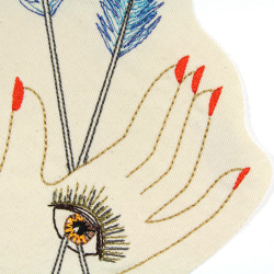 Hand embroidered detail image with eye and arrows as an iron-on patch for adults