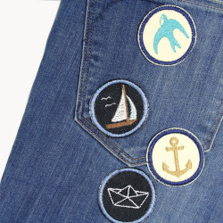 Maritime trouser patches for adults, small and round. Just iron it on and fix the pants.
