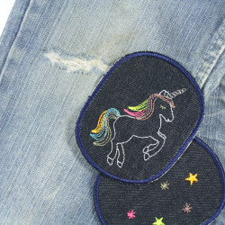 Jeans with unicorn patches and asterisk patch to iron on on the knee repaired and concealed stains