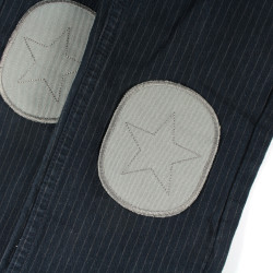 simple iron-on patches in gray with a star made of organic jeans to iron on on dark trousers