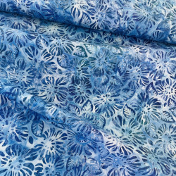 Cotton fabric by Robert Kaufman with a garden of leaves in blue batik