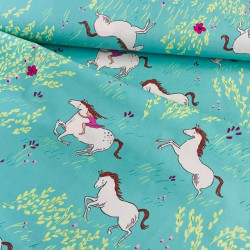 Fabrics riding in summer turquoise cotton fabric by Michael Miller
