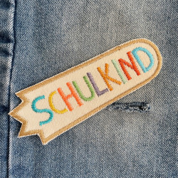 Iron-on patches for schoolchildren to repair jeans