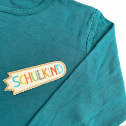 Iron-on patch for schoolchildren on organic cotton fabric as a decoration on T-shirt