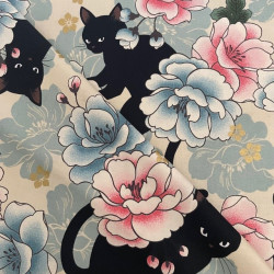 Quilt fabrics with a motif of a cat and a blossom cotton fabric