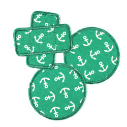 3 iron-on patches with white anchors on green