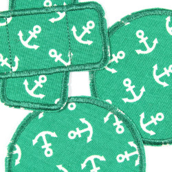 2 round iron-on patches and 1 plaster iron-on patch with anchor motif white on green