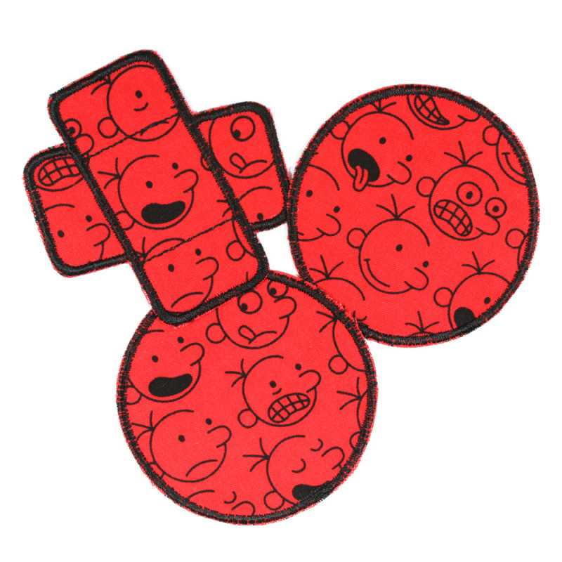 3 iron-on patches with comic faces black on red