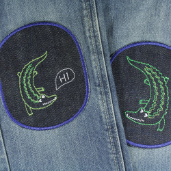 Jeans with crocodile patches to iron on. Trousers on the knee repaired and stains concealed