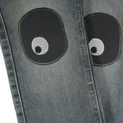 Iron-on repair patches with a pair of eyes, ideal as knee patches for children