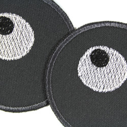2 round iron-on patches with eye motif for children